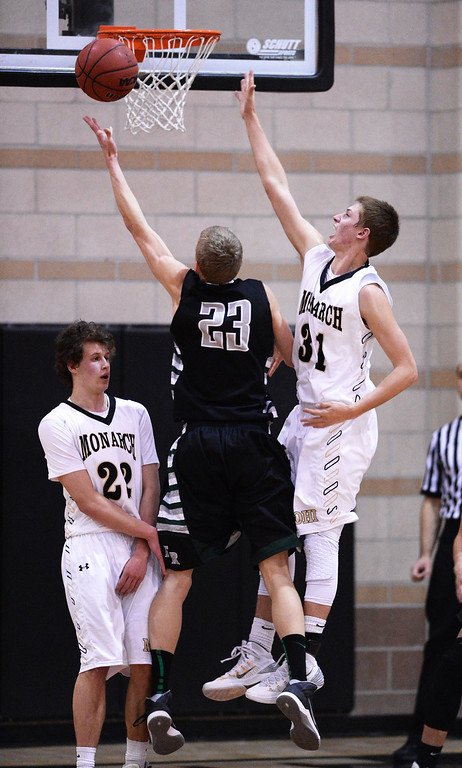 . Alex Semadeni of Fossil Ridge High School (23), makes basket over Ben Beuchamp of Monarch High School (31) in the 2nd half of the game at Monarch High School Gym. Louisville.   (Photo by Hyoung Chang/The Denver Post)
