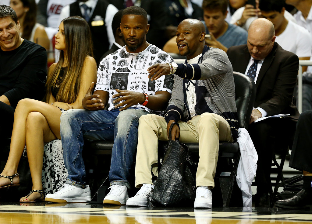 . MIAMI, FL - JUNE 10: Actor Jamie Foxx (left) and boxer Floyd Mayweather Jr. (right) attend Game Three of the 2014 NBA Finals between the Miami Heat and the San Antonio Spurs at American Airlines Arena on June 10, 2014 in Miami, Florida.  (Photo by Andy Lyons/Getty Images)