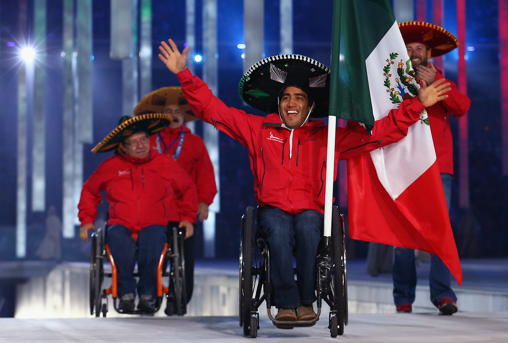 . Mexico enters the arena lead by flag bearer Arly Velasquez during the Opening Ceremony of the Sochi 2014 Paralympic Winter Games at Fisht Stadium on March 7, 2014 in Sochi, Russia.  (Photo by Tom Pennington/Getty Images)