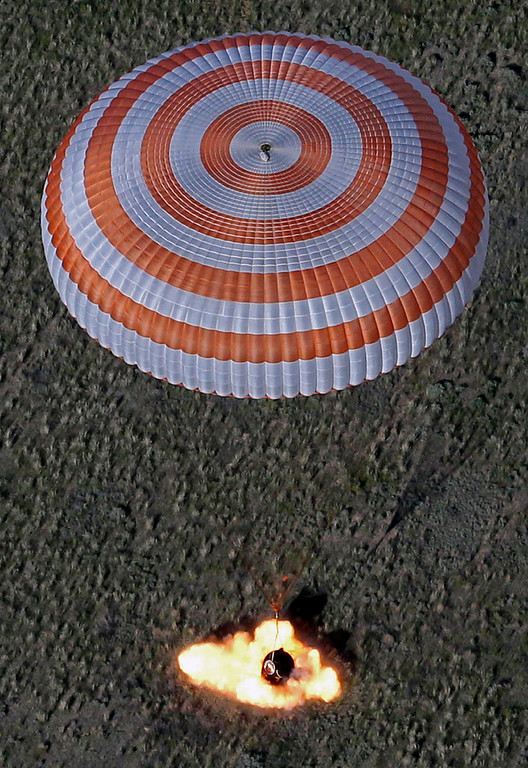 . A fire of the Russian Soyuz TMA-07M space capsule breaking engines goes out as it lands about 150 km (90 miles) south-east of the Kazakh town of Dzhezkazgan, Kazakhstan, Tuesday, May 14, 2013. (AP Photo/Mikhail Metzel, pool)