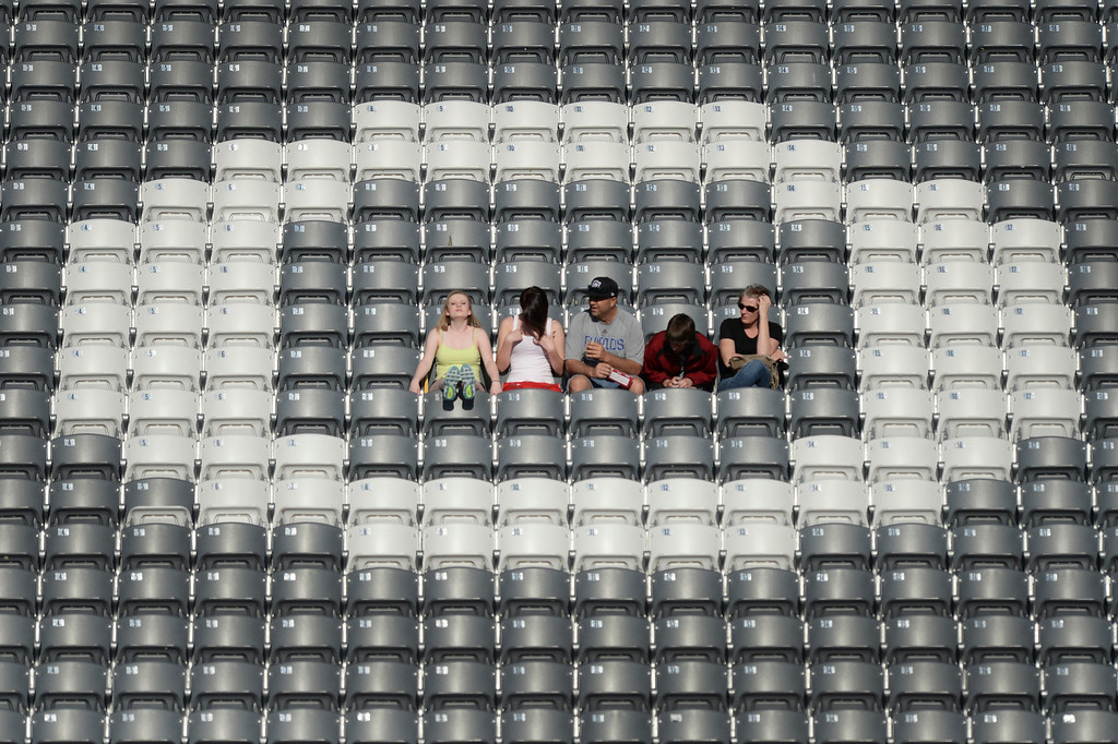 """. COMMERCE CITY, CO - MAY 3:  Early arriving fans took up positions inside the letter \""""O\"""" in the word Colorado in the east stands. The Colorado Rapids hosted the Los Angeles Galaxy Saturday night, May 3, 2014 at Dick\'s Sporting Good Park. (Photo by Karl Gehring/The Denver Post)"""