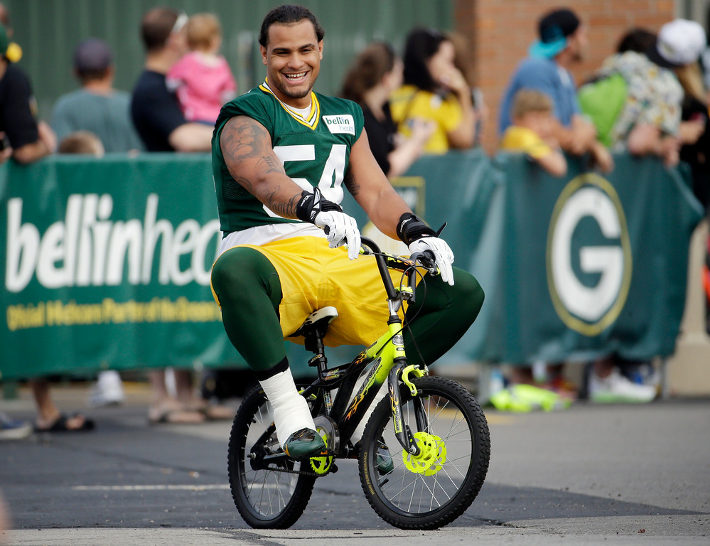 . Green Bay Packersí Carl Bradford rides a bike to NFL football training camp on Saturday, July 26, 2014, in Green Bay, Wis. (AP Photo/Morry Gash)
