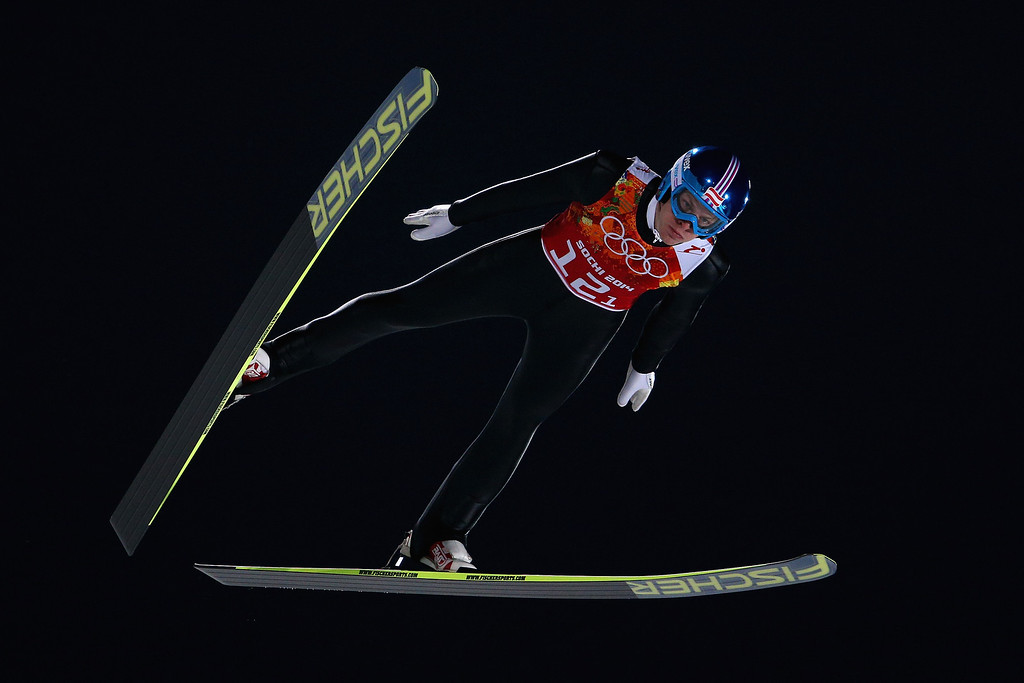 . Michael Hayboeck of Austria jumps during the Men\'s Team Ski Jumping trial on day 10 of the Sochi 2014 Winter Olympics at the RusSki Gorki Ski Jumping Center on February 17, 2014 in Sochi, Russia.  (Photo by Paul Gilham/Getty Images)