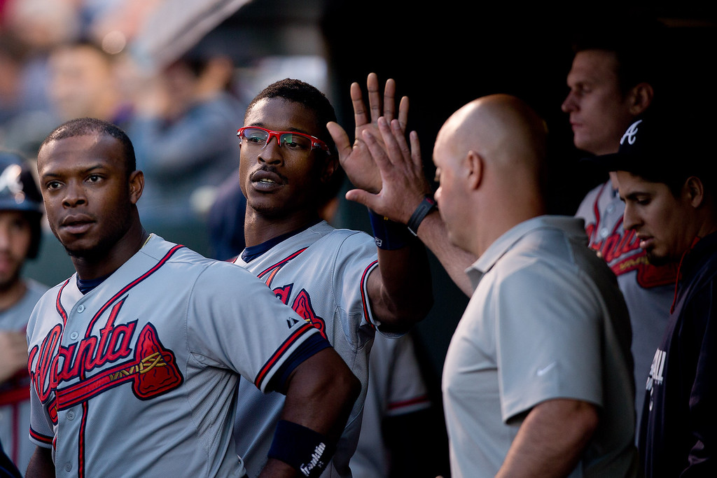 . Justin Utpton #8 of the Atlanta Braves celebrates in the dugout after scoring during the fourth inning against the Colorado Rockies at Coors Field on June 9, 2014 in Denver, Colorado.  (Photo by Justin Edmonds/Getty Images)