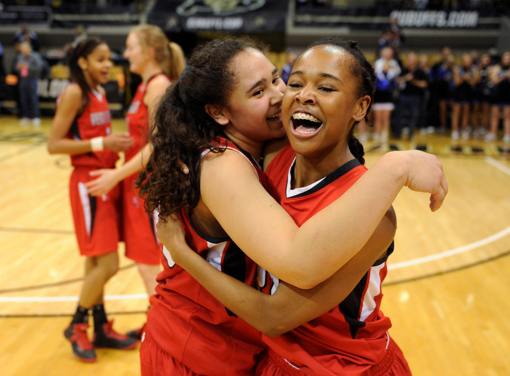 . BOULDER, CO. - MARCH 16: Kelsi Lidge and Neffie Lockley celebrated the win. The Regis Jesuit High School girl\'s basketball team defeated Highlands Ranch 53-46 in the 5A championship game Saturday, March 16, 2013 at the Coors Events Center in Boulder.  (Photo By Karl Gehring/The Denver Post)
