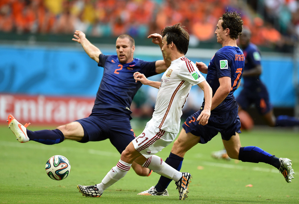 . (L-R) Netherlands\' defender Ron Vlaar, Spain\'s midfielder David Silva and Netherlands\' defender Daryl Janmaat vie for the ball during a Group B football match between Spain and the Netherlands at the Fonte Nova Arena in Salvador during the 2014 FIFA World Cup on June 13, 2014.  AFP PHOTO / JAVIER SORIANO/AFP/Getty Images