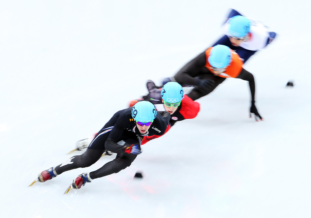 . SOCHI, RUSSIA - FEBRUARY 13:  (L-R) Chris Creveling of the United States, Charle Cournoyer of Canada, Niels Kerstholt of the Netherlands  and Jon Eley of Great Britain compete in the Short Track Men\'s 1000m Heats on day 6 of the Sochi 2014 Winter Olympics at at Iceberg Skating Palace on February 13, 2014 in Sochi, Russia.  (Photo by Quinn Rooney/Getty Images)