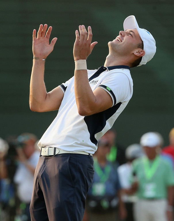 . Martin Kaymer of Germany celebrates his eight-stroke victory on the 18th green during the final round of the 114th U.S. Open at Pinehurst Resort & Country Club, Course No. 2 on June 15, 2014 in Pinehurst, North Carolina.  (Photo by Andrew Redington/Getty Images)