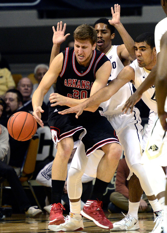 . University of Colorado\'s Spencer Dinwiddie (25) and Josh Scott (40) guard against Arkansas State\'s  Kirk Van Slyke (20) during their game at the Coors Events Center on the CU Boulder Campus in Boulder, Colorado on November 18, 2013.  Photo by Paul Aiken / The Boulder Daily Camera.