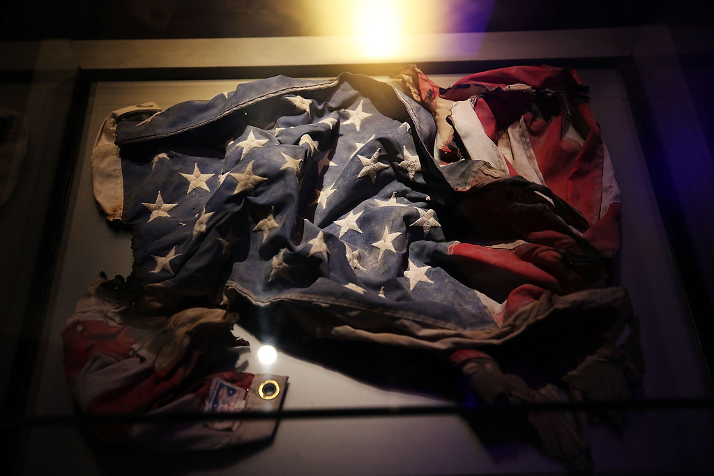 . An American Flag recovered from the World Trade Center site is viewed during a preview of the National September 11 Memorial Museum on May 14, 2014 in New York City.  (Photo by Spencer Platt/Getty Images)
