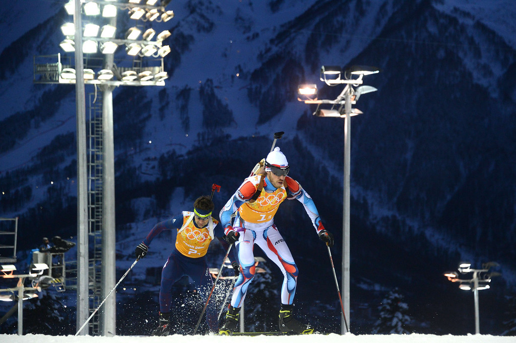 . Norway\'s Ole Einar Bjoerndalen and Czech Republic\'s Jaroslav Soukup (R) compete in the Biathlon mixed 2x6 km + 2x7,5 km Relay at the Laura Cross-Country Ski and Biathlon Center during the Sochi Winter Olympics on February 19, 2014 in Rosa Khutor near Sochi.  AFP PHOTO / KIRILL KUDRYAVTSEV/AFP/Getty Images