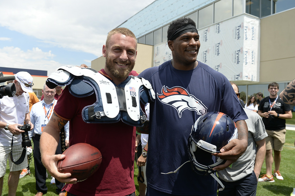 . Denver Broncos tight end Julius Thomas (80) poses with AS Roma player Daniele De Rossi after practice of the Denver Broncos 2014 training camp July 25, 2014 at Dove Valley. (Photo by John Leyba/The Denver Post)