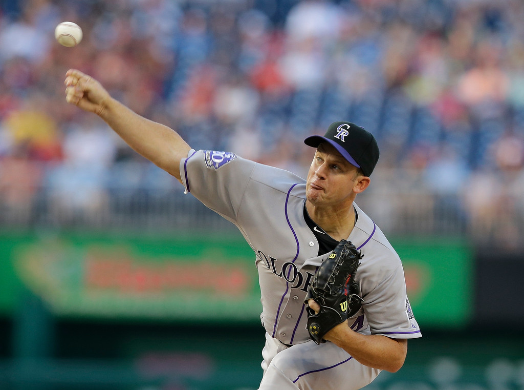 . Colorado Rockies starting pitcher Roy Oswalt throws during the first inning of a baseball game against the Washington Nationals at Nationals Park, Thursday, June 20, 2013, in Washington. (AP Photo/Alex Brandon)