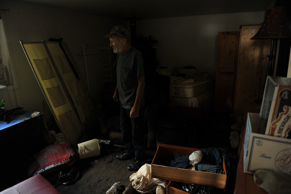 . LONGMONT, CO - September 19 : Jerry Nopens, 73, has been at his house for 5 days trying to clean up in Longmont, Colorado. September 19, 2013.  (Photo by Hyoung Chang/The Denver Post)