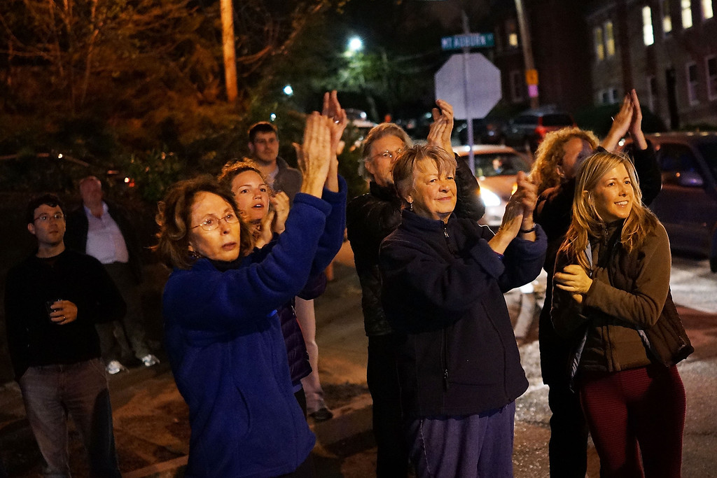 . WATERTOWN, MA - APRIL 19:  Women cheer police as they exit Franklin Street after 19-year-old bombing suspect Dzhokhar A. Tsarnaev  was apprehended on April 19, 2013 in Watertown, Massachusetts. A manhunt for Boston Marathon bombing suspect Tsarnaev ended this evening with his capture on a boat parked on a residential property in Watertown, Massachusetts. His brother Tamerlan Tsarnaev, 26, the other suspect, was shot and killed by police early this morning after a car chase and shootout with police. The two men are suspects in the bombings at the Boston Marathon on April 15 that killed three people and wounded at least 170.(Photo by Spencer Platt/Getty Images)