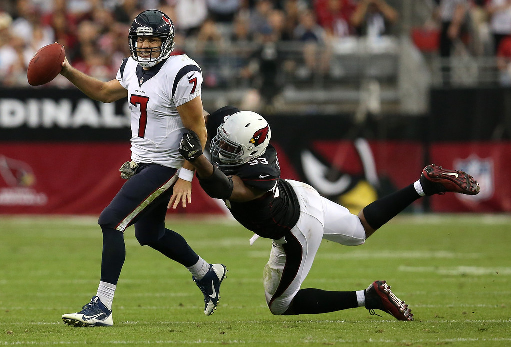 . Quarterback Case Keenum #7 of the Houston Texans is hurried into throwing the ball away out of bounds by defensive end Calais Campbell #93 of the Arizona Cardinals at University of Phoenix Stadium on November 10, 2013 in Glendale, Arizona.  (Photo by Stephen Dunn/Getty Images)