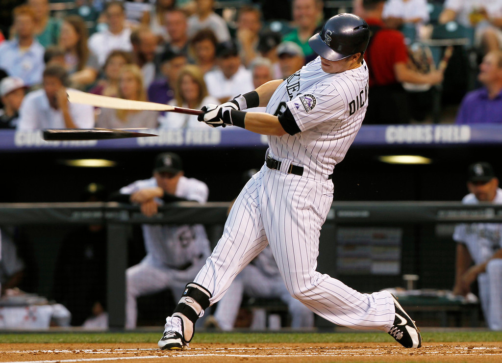 . Colorado Rockies\' Corey Dickerson breaks his bat while grounding out against the Cincinnati Reds in the first inning of a baseball game in Denver on Saturday, Aug. 31, 2013. (AP Photo/David Zalubowski)