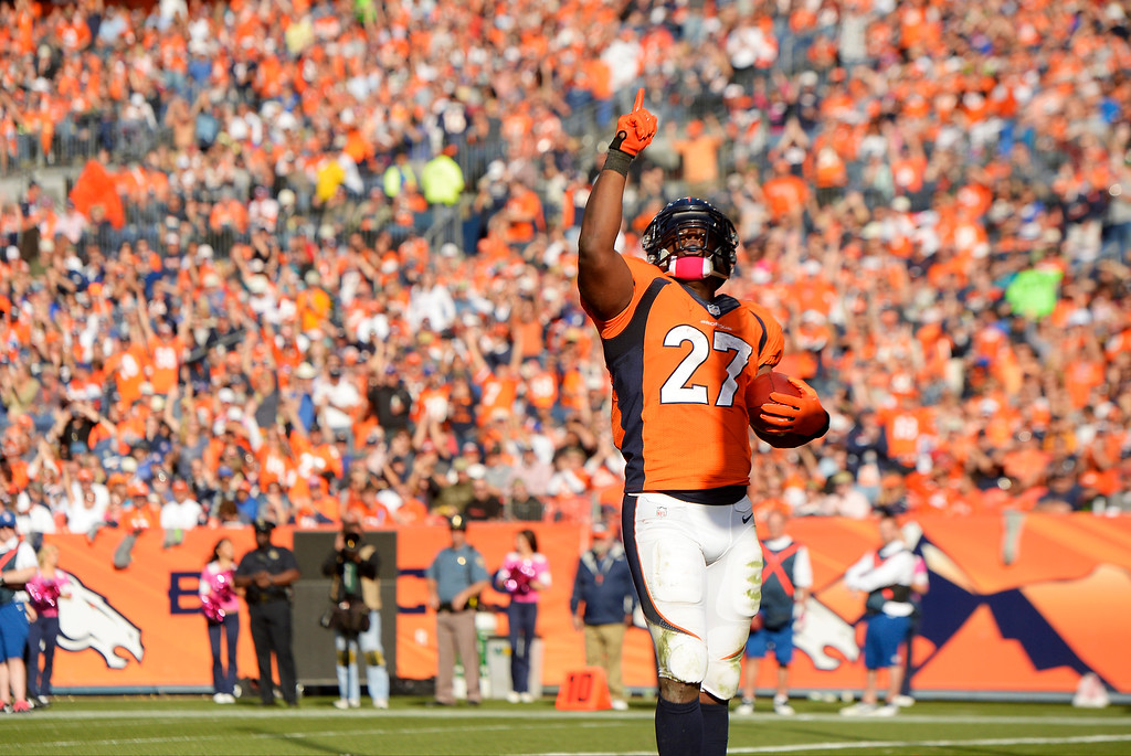 . Denver Broncos running back Knowshon Moreno (27) celebrates a touchdown run in the third quarter, as the Denver Broncos took the Jacksonville Jaguars at Sports Authority Field at Mile High in Denver on October 13, 2013. (Photo by Joe Amon/The Denver Post)