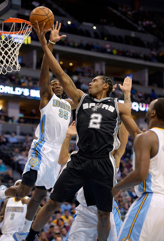 . San Antonio Spurs small forward Kawhi Leonard (2) drives to the basket on Denver Nuggets small forward Kenneth Faried (35) during the first quarter  October 14, 2013 at Pepsi Center. (Photo By John Leyba/The Denver Post)