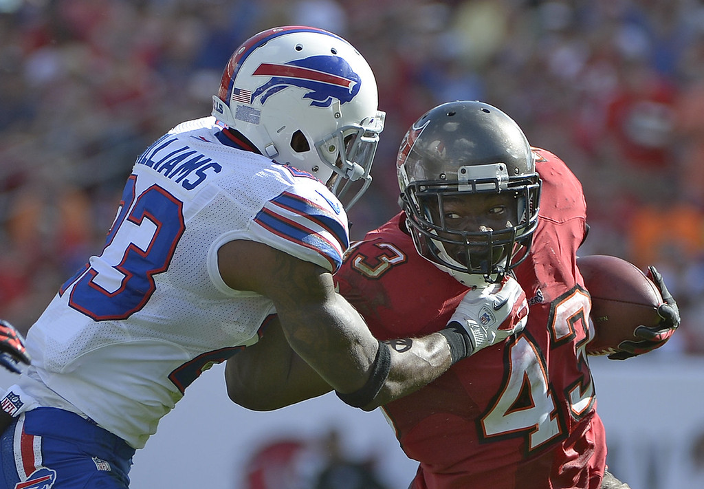 . Tampa Bay Buccaneers running back Bobby Rainey (43) is hit by Buffalo Bills free safety Aaron Williams (23) during the second quarter of an NFL football game on Sunday, Dec. 8, 2013, in Tampa, Fla. (AP Photo/Phelan M. Ebenhack)