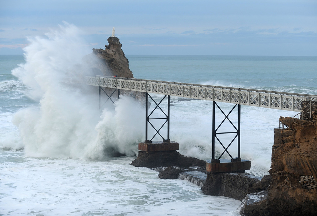. A wave hits the Rock of the Virgin Mary (Rocher de la Vierge) as a storm brings strong winds on January 6, 2014 in Biarritz, south western France. GAIZKA IROZ/AFP/Getty Images
