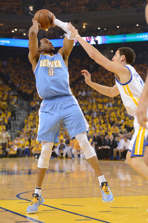. Andre Iguodala (9) of the Denver Nuggets takes a shot over Klay Thompson (11) of the Golden State Warriors during the first quarter in Game 6 of the first round NBA Playoffs May 2, 2013 at Oracle Arena. (Photo By John Leyba/The Denver Post)