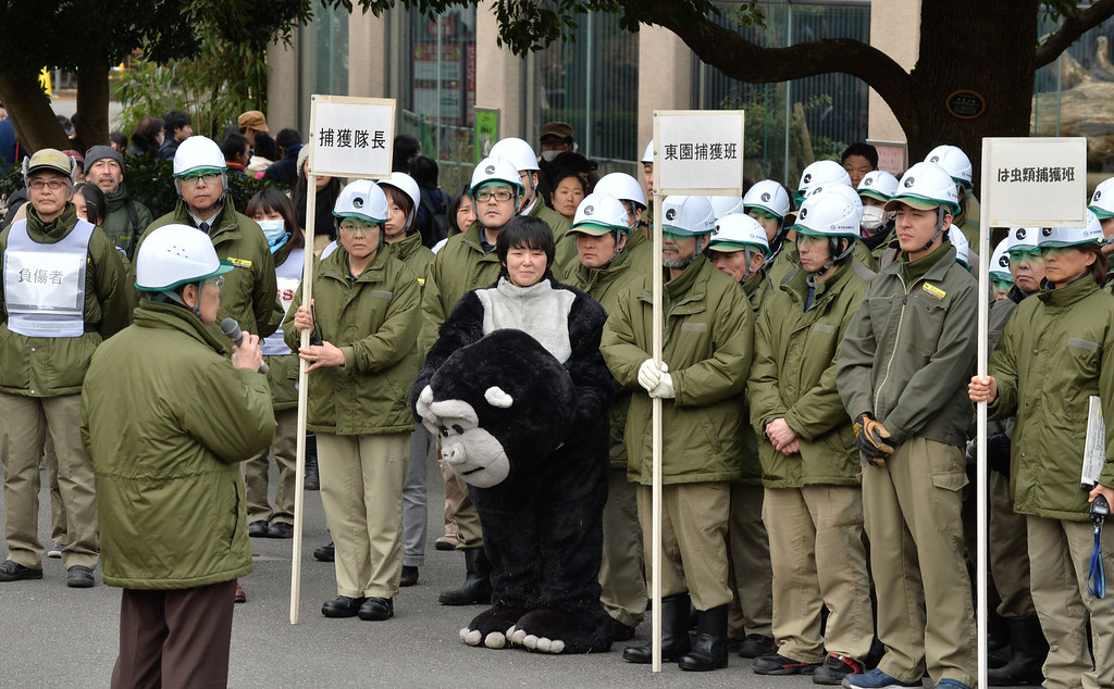 . Zookeepers hold a meeting after a drill to practice what to do in the event of an animal escape at the Ueno zoo in Tokyo on February 6, 2014. About 70 zookeepers participated in the annual drill.     AFP PHOTO / KAZUHIRO NOGI/AFP/Getty Images