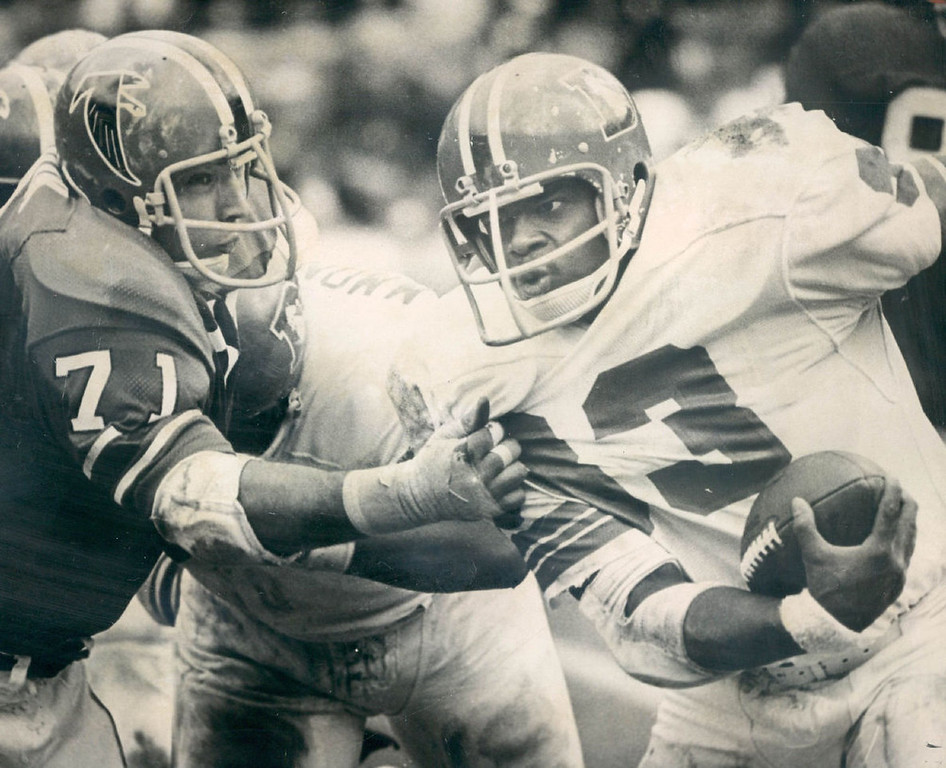 . Broncos\' running back Joe Dawkins (33) got past this hand tackle by Atlanta defensive end John Zook (71), being blocked by Bronco offensive tackle Montgomery. Dawkins gained 6 yds. 1972.   (Photo by David Cupp/Denver Post, Inc.)