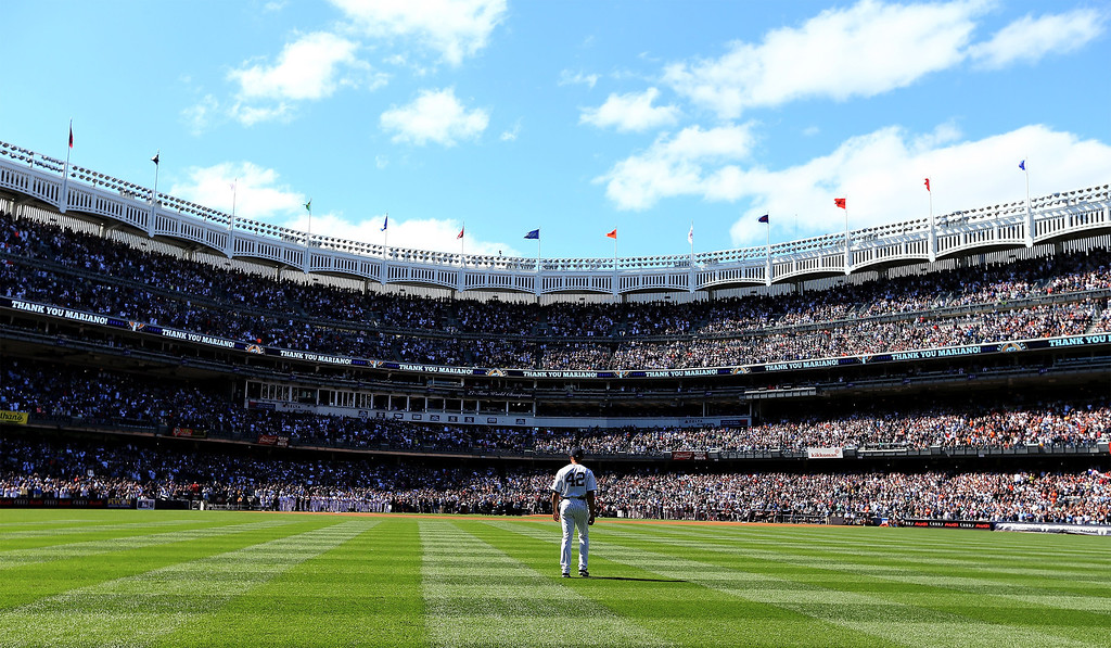 . Mariano Rivera #42 of the New York Yankees walks out of the bullpen before the game against the San Francisco Giants during interleague  play on September 22, 2013 at Yankee Stadium in the Bronx borough of New York City. Rivera was honored by the New York Yankees today with Mariano Rivera Day.  (Photo by Elsa/Getty Images)