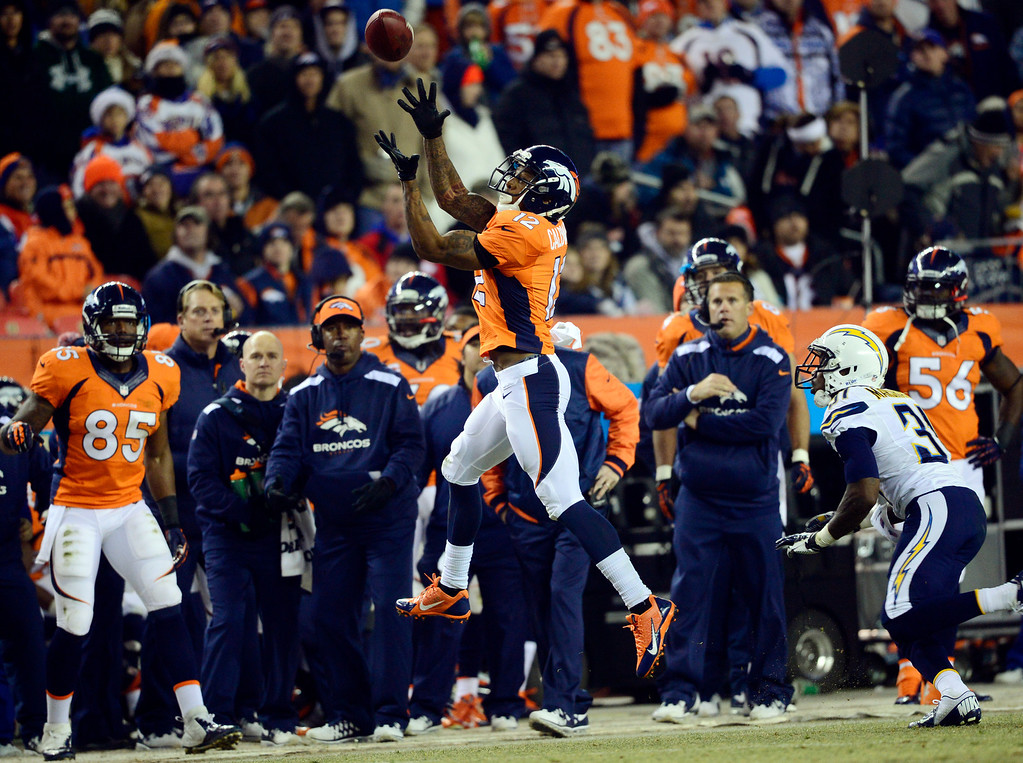 . DENVER, CO - DECEMBER 12: Denver Broncos wide receiver Andre Caldwell (12) goes out of bounds and doesn\'t complete the pass during the first half.  The Denver Broncos vs. the San Diego Chargers at Sports Authority Field at Mile High in Denver on December 12, 2013. (Photo by AAron Ontiveroz/The Denver Post)