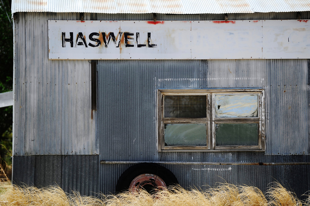 Description of . HASWELL, CO - MAY 29:  Sometimes just a simple composition of scenes that you might otherwise pass up, makes the best photographs. In this case, an abandoned auto repair shop and former health clinic in the little farm town in southeast Colorado, Haswell, Colorado, Wednesday May 29, 2013. The Intel Corporation, an American multi-national semiconductor computer chip maker, has codenamed their latest and greatest new chip after the small town of Haswell.  (Photo By Andy Cross/The Denver Post)