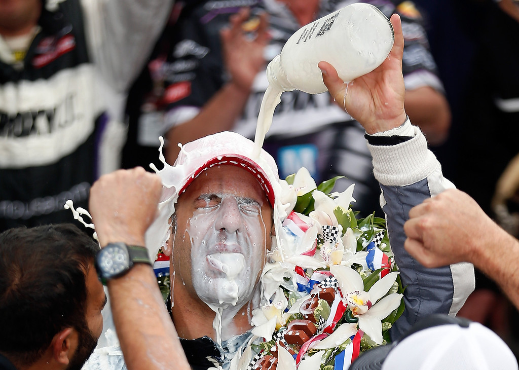 . Tony Kanaan of Brazil, driver of the Hydroxycut KV Racing Technology-SH Racing Chevrolet, pours the victory milk over his head as he celebrates in victory lane after winning the IZOD IndyCar Series 97th running of the Indianpolis 500 mile race at the Indianapolis Motor Speedway on May 26, 2013 in Indianapolis, Indiana.  (Photo by Chris Graythen/Getty Images)