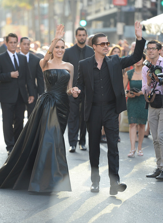 . Actors Angelina Jolie and Brad Pitt attend the World Premiere of Disney\'s \'Maleficent\' at the El Capitan Theatre on May 28, 2014 in Hollywood, California.  (Photo by Jason Merritt/Getty Images)