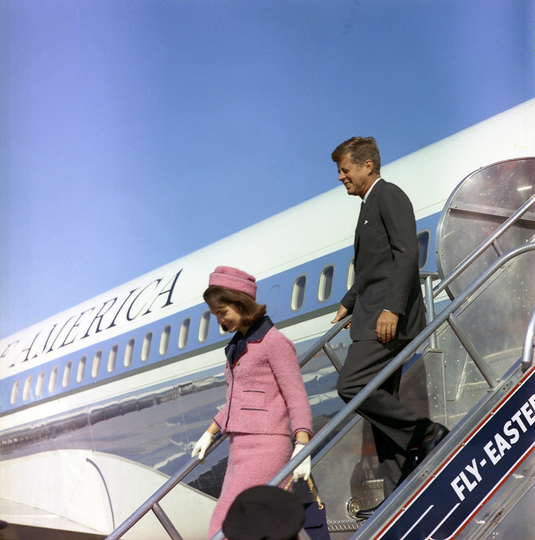 . Kennedy and the first lady descend the stairs from Air Force One at Love Field in Dallas. Cecil Stoughton/John F. Kennedy Presidential Library and Museum