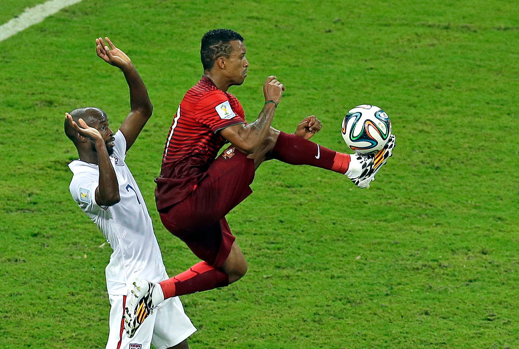 . Portugal\'s Nani controls a ball as United States\' DaMarcus Beasley, left, looks on during the group G World Cup soccer match between the USA and Portugal at the Arena da Amazonia in Manaus, Brazil, Sunday, June 22, 2014. (AP Photo/Themba Hadebe)