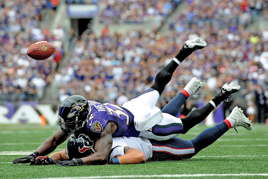 . Strong safety James Ihedigbo #32 of the Baltimore Ravens breaks up a pass intended for tight end Owen Daniels #81 of the Houston Texans at M&T Bank Stadium on September 22, 2013 in Baltimore, Maryland.  (Photo by Larry French/Getty Images)