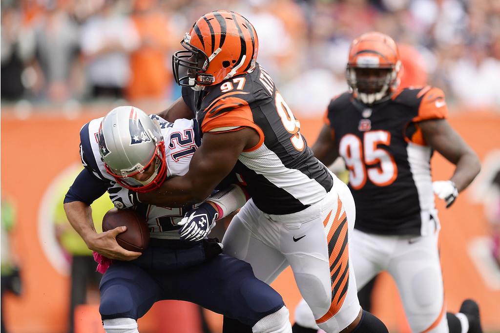 . Geno Atkins #97 of the Cincinnati Bengals sacks quarterback Tom Brady #12 of the New England Patriots in the first quarter at Paul Brown Stadium on October 6, 2013 in Cincinnati, Ohio.  (Photo by Jamie Sabau/Getty Images)