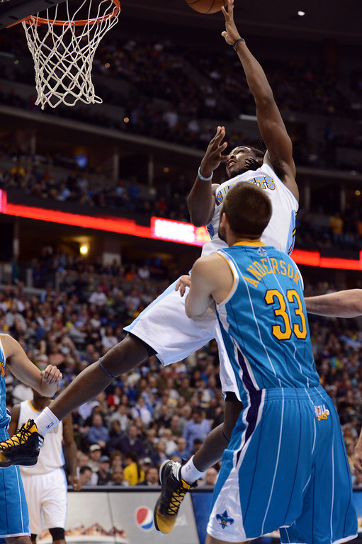 . DENVER, CO. - FEBRUARY 01: Kenneth Faried of Denver Nuggets #35 jumps for the basket over Ryan Anderson of New Orleans Hornets #33 in the 2nd half of the game on February 1, 2013 at the Pepsi Center in Denver, Colorado. Denver won 113-98. (Photo By Hyoung Chang/The Denver Post)