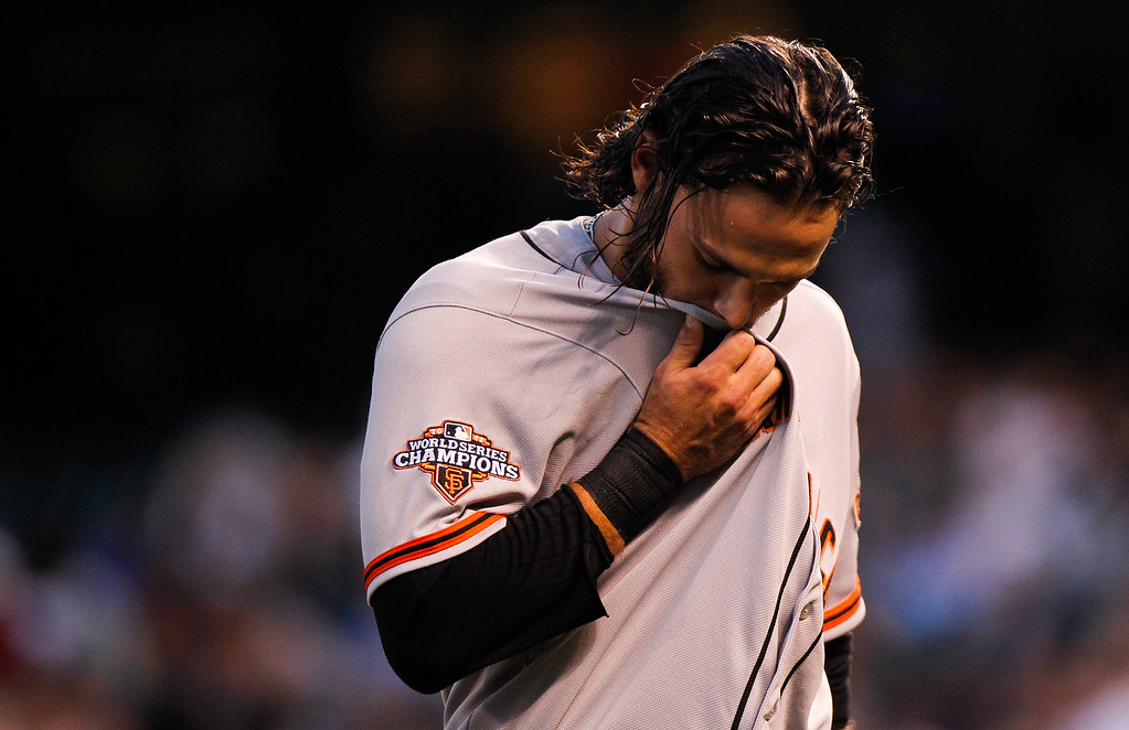 . San Francisco Giants\' Brandon Crawford heads to the dugout after being stranded during the third inning of a baseball game against the Colorado Rockies, Wednesday, Aug. 28, 2013, in Denver. (AP Photo/Barry Gutierrez)