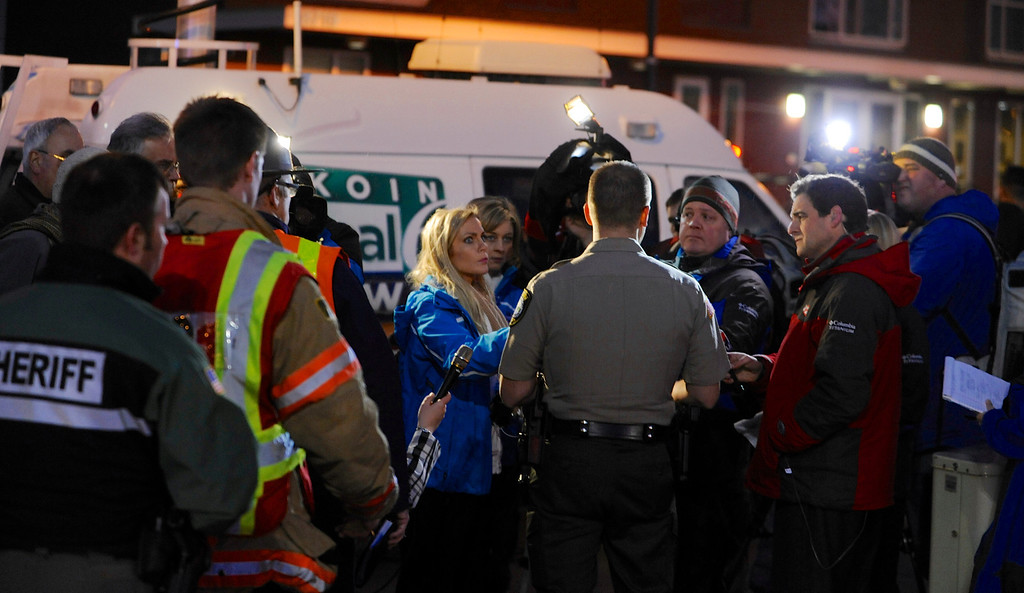 . Media gather around Clackamas County sheriff\'s Lt. James Rhodes during a news conference at the scene of a multiple shooting at Clackamas Town Center Mall in Clackamas, Ore., Tuesday Dec. 11, 2012. A gunman is dead after opening fire in the Portland, Ore., area shopping mall Tuesday, killing two people and wounding another, sheriff\'s deputies said. (AP Photo/Greg Wahl-Stephens)
