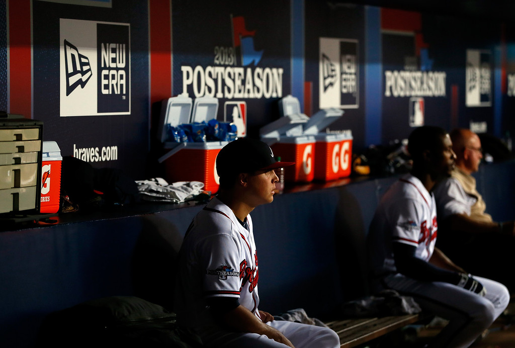 . ATLANTA, GA - OCTOBER 03: Kris Medlen #54 of the Atlanta Braves sits in the dugout after being pulled in the fifth inning against the Los Angeles Dodgers during Game One of the National League Division Series at Turner Field on October 3, 2013 in Atlanta, Georgia.  (Photo by Kevin C. Cox/Getty Images)