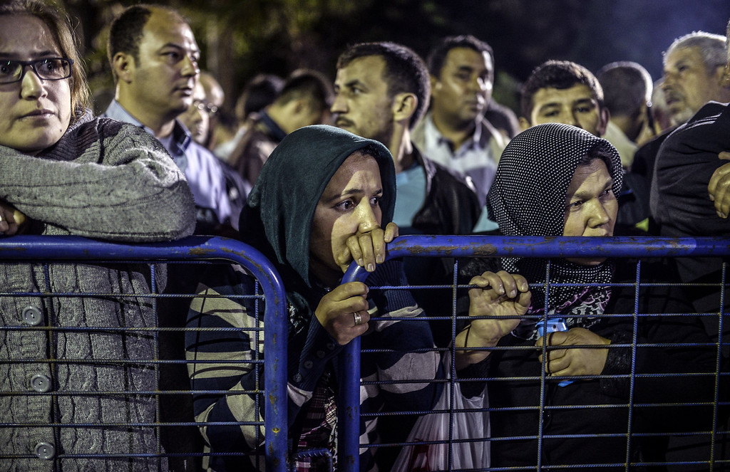 . People stand in front of a hospital as they wait for news from her relatives on May 14, 2014.   AFP PHOTO/BULENT KILIC/AFP/Getty Images