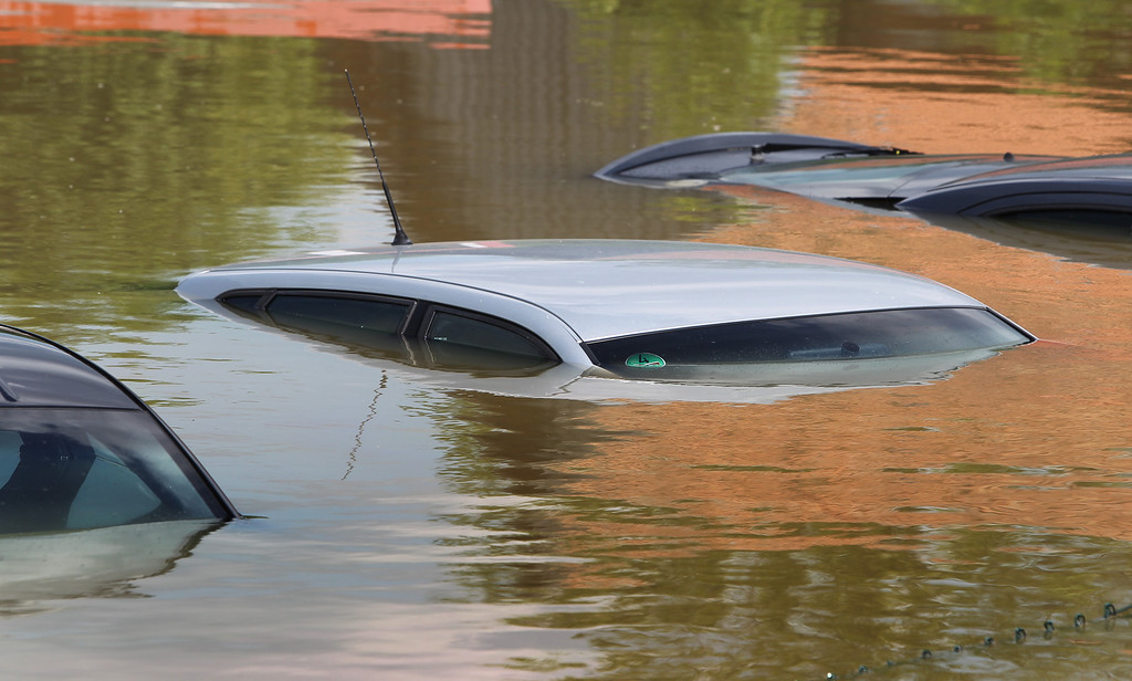 . Rooftops of submerged cars rise out of the floods in Deggendorf, southern Germany, on June 5, 2013.    AFP PHOTO / KARL-JOSEF HILDENBRAND /AFP/Getty Images