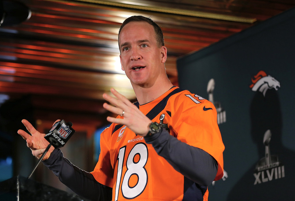 . Peyton Manning of the Denver Broncos addresses the media during Super Bowl XLVIII media availability on January 30, 2014 in Jersey City, New Jersey. The Denver Broncos and Seattle Seahawks will meet in Super Bowl XLVIII at Metlife Stadium on February 2, 2014.  (Photo by Elsa/Getty Images)