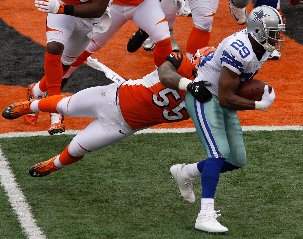 . Dallas Cowboys running back DeMarco Murray (29) is tackled by Cincinnati Bengals outside linebacker Vontaze Burfict (55) in the first half of an NFL football game, Sunday, Dec. 9, 2012, in Cincinnati. (AP Photo/Tom Uhlman)