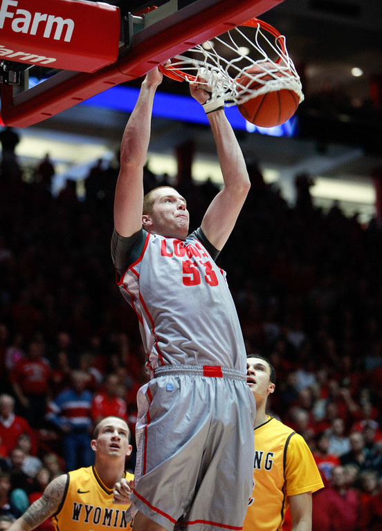 . New Mexico\'a Alex Kirk dunks as Wyoming\'s Josh Adams, left, and Larry Nance Jr. watch during the first half of an NCAA college basketball game in Albuquerque, N.M., Saturday, March 2, 2013. (AP Photo/Craig Fritz)
