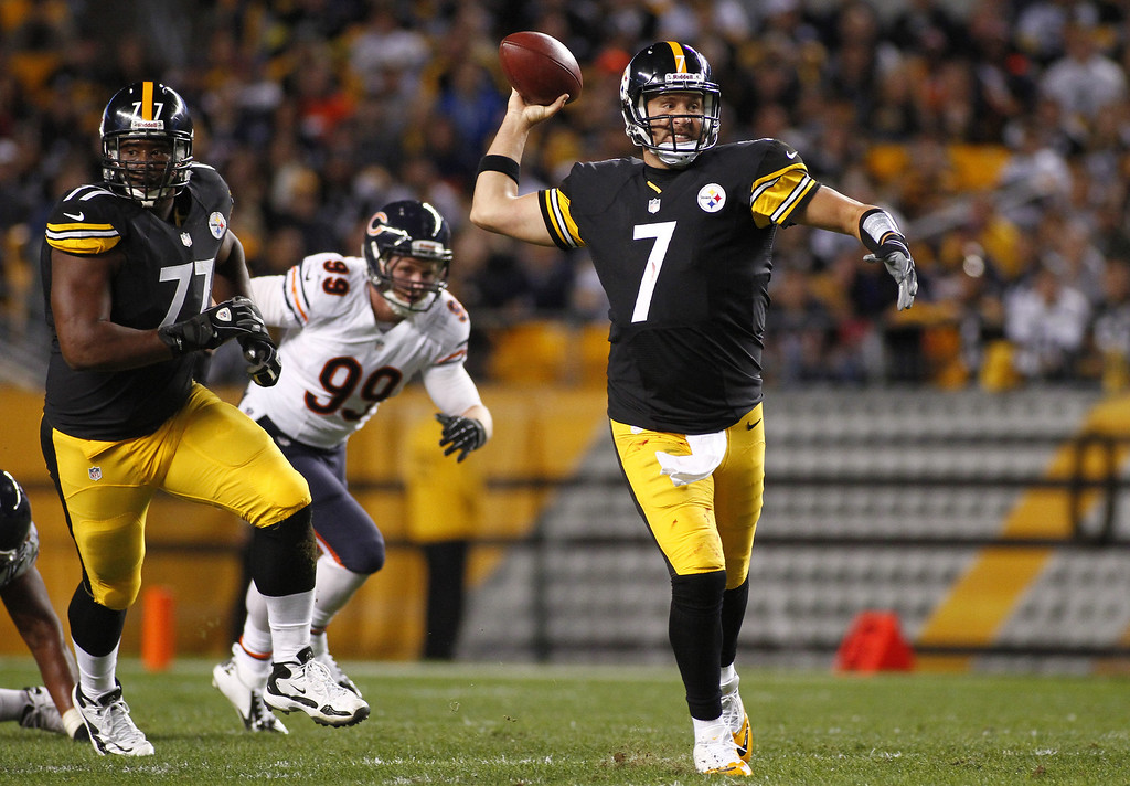 . Ben Roethlisberger #7 of the Pittsburgh Steelers attempts a pass out of the pocket against the Chicago Bears during the game on September 22, 2013 at Heinz Field in Pittsburgh, Pennsylvania.  (Photo by Justin K. Aller/Getty Images)