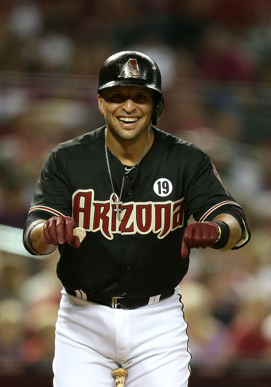 . PHOENIX, AZ - JULY 05:  Martin Prado #14 of the Arizona Diamondbacks reacts as he bats against the Colorado Rockies during the MLB game at Chase Field on July 5, 2013 in Phoenix, Arizona.  (Photo by Christian Petersen/Getty Images)
