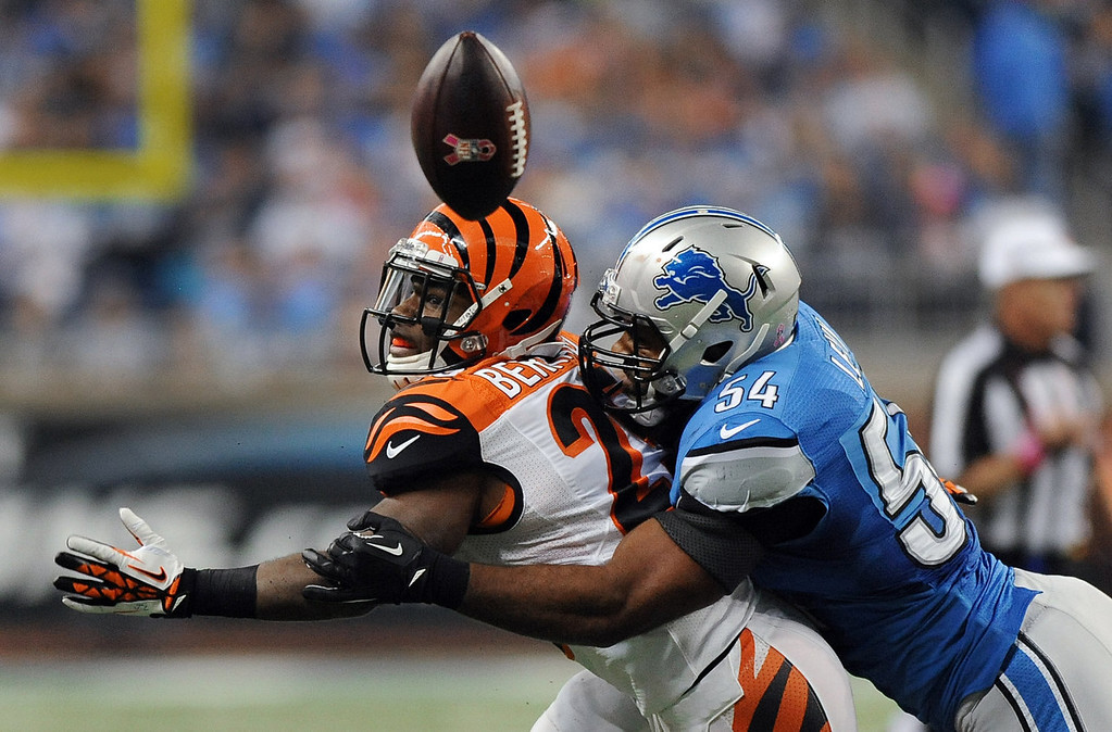 . Detroit Lions outside linebacker DeAndre Levy (54) breaks up a pass intended for Cincinnati Bengals running back BenJarvus Green-Ellis (42) in the second quarter of an NFL football game against Sunday, Oct. 20, 2013, in Detroit. (AP Photo/Jose Juarez)