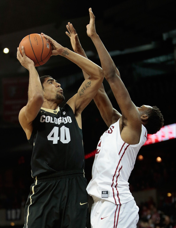 . Josh Scott #40 of the Colorado Buffaloes puts up a shot against Junior Longrus #15 of the Washington State Cougars during the second half at Spokane Arena on January 8, 2014 in Spokane, Washington.  (Photo by William Mancebo/Getty Images)
